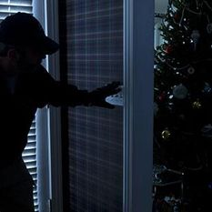Burgler entering home